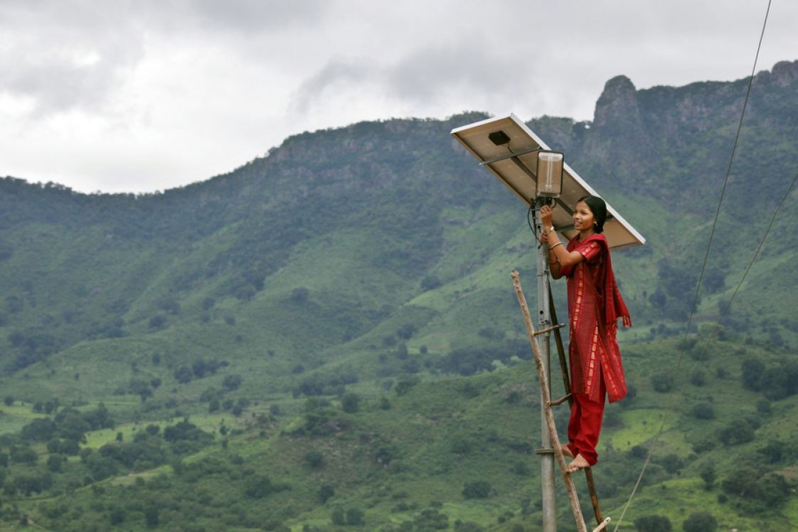 A solar engineer maintains the street lighting in her village of Tinginaput, India — a rural area not connected to the region's main electrical grid. Credits: Photo: Abbie Trayler-Smith/Panos Pictures